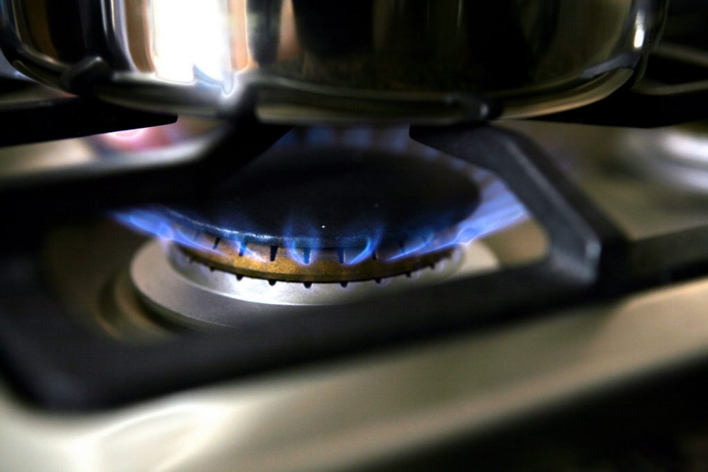 gas burner on stove with pot
